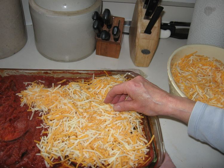 Topping off with grated cheese